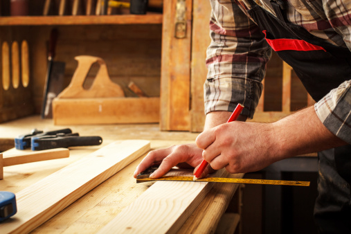 Carpenter working with tools.